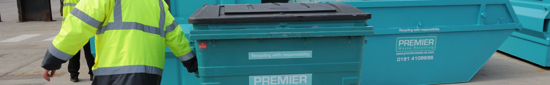 A Premier Waste Recycling employee at work.
