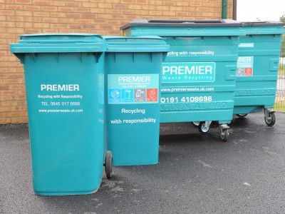 Wheeled bins against a wall.